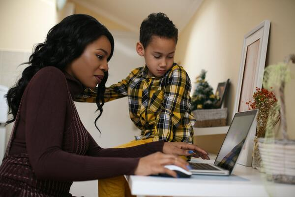 Woman on laptop with son